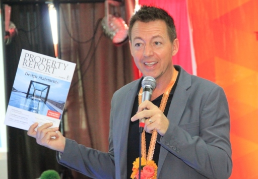 Mr. Jules Kay, Managing Editor of Ensign Media, presents the Property Report magazine.