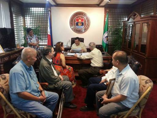 """Realtor Dr. Kirby Salvador, Appraiser Ramon CF Cuervo III and Real Estate Consultant Fernando Camus present to Manila Mayor Joseph """"Erap"""" Ejercito Estrada with other private civic leaders their proposal in assisting the city of Manila in their efforts to achieve financial and economic sustainability for the city of Manila."""