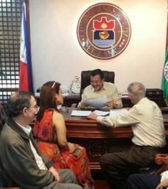 "Realtor Dr. Kirby Salvador, Appraiser Ramon CF Cuervo III and Real Estate Consultant Fernando Camus present to Manila Mayor Joseph ""Erap"" Ejercito Estrada"