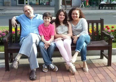 Fernando and Lizel Cuervo with their son and daughter.