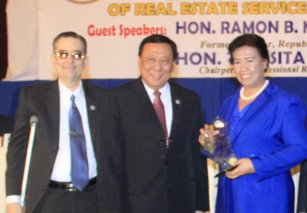 from left: Board Member of Real Estate Service Mr. Ramon CF Cuervo III, Chairman of the Board of Real Estate Service Dr. Eduardo Gutierrez Ong and PRC Chairperson Atty. Teresita R. Manzala