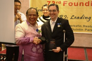 Mr. Ramon CF Cuervo III with Manila Real Estate Board, Inc former President Romy Lacsamana shake hands cheerfully