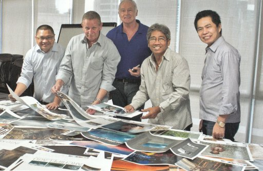 Final checking of color proofs. From left: Manuel N Roma Jr., Simon Leith, Louis-Paul Heussaff, George Tapan, and Eugene Ong.